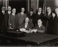 Gov. Franklin D. Roosevelt signs modern public welfare law, 1929. Former SCAA Executive Director Homer Folks is 2nd from the left.